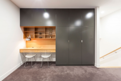 desk timber finish and dark grey wardrobes