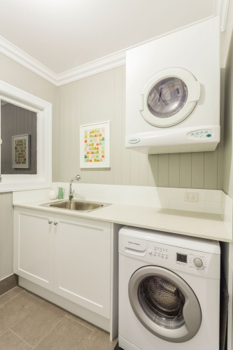 small laundry with shaker style doors - washing machine and dryer