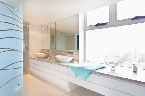 Moden white vanity built in a luxury apartment Broad Beach
