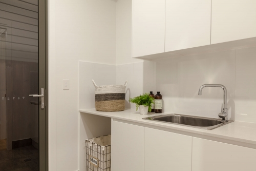 Laundry with base cabinets and overhead cabinets 2pac white finish